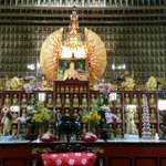 The main prayer hall with the ten thousand buddhas all around the walls