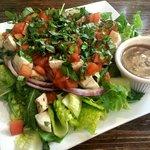 Bruschetta Chicken Salad. Very delicious meal with spinach, tomatoes, garlic, basil, mozzarella,