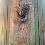 Detail of one of the antique doors on the patio fence