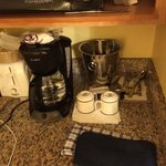 The coffee maker and silverware provided in the room