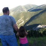 My dad and little sister looking out at the mountains