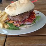 Angus beef steak burger with garlic butter and chips/salad.