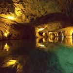 Lit, and flooded Artificial cave