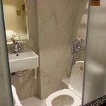 The toilet- the metal faucet by the toilet is not a bidet it's the shower!