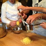 ricing the potatoes for gnocchi