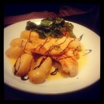 sole with a lemon, parsley and caper butter served on top of anew potatoes and accompanied with