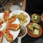 Selection of tapas- pan tomate, popcorn shrimp, artichoke hearts, potato tortilla