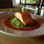 Pan seared salmon, broccoli puree, green onion oil, roasted red pepper sauce.