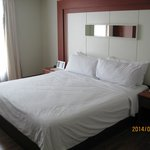 Bed in room of Cool Studio
