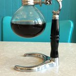 Russian vacuum coffee maker brought to the table