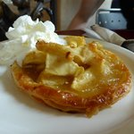 Warm apple tart with whipped cream