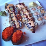 Godzilla roll, spicy yellowtail roll, and smelt roe at Fujo