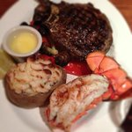 ribeye with lobster tail and twice baked potatoes