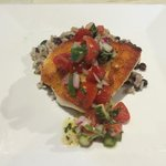 Sautéed hog snapper with cherry tomato, cucumber, jalapeño and cilantro relish served with Black