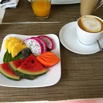 Fresh fruits platter & coffee for breakfast