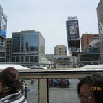 View across Dundas Square with Bond Place hotel near the right of the photo.