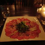 Beef carpaccio with truffle mayonaise, pinenuts and Parmesan cheese