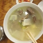 Beef rib soup with clear noodles, egg and vegetables