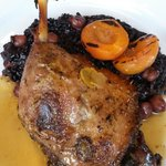 Steamed, roasted Gressingham duck leg, with black rice, chickpeas and grilled apricot