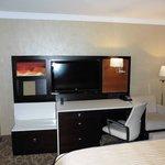 Large screen TV, desk/storage area