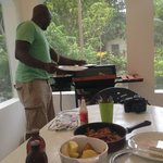 Richie (JuJu's guide) serving delicious lobster at Blossom's villa