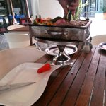 Grigliata di carne delivered to the table still on the grill