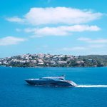 A sleek motor yacht cruising by the Barcelo Hamilton Menorca (c) Josh Murray