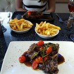 t-bone and sirloin steaks with chips