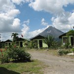 VIEW OF RESORT COTTAGES WITH VOLCANO ARENAL IN THE BACKGROUND