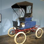 Early electric car!  Do you know why the wheels are white?
