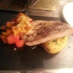 hasselback garlic an parsly potato with watermelon stir fry and swordfish fillet