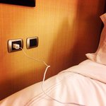Multiple electric outlets next to the bed - hooray!!