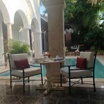 Outdoor dining view to pool; loved eating breakfast here