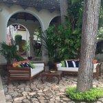 Lounge area behind pool