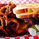 THE Cheeseburger ( burger between two grilled cheese sandwiches) and the tobacco onion straws