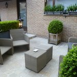 Outside seating area, near the outside rooms