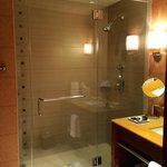 Large walk-in shower with glass door.