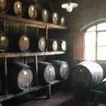 Aging sweet Vin Santo wine 4-7 years in old oak casks using a centuries-old oxygenation method