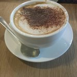 Cafe latte. Deliciously wonderful with choco sprinkled on top.