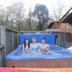 hot tub on decking outside lodge