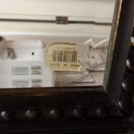 old price tag still on gaudy mirror.  Their attempt to remodel?