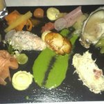 Platter of Fish starters served on a slate.