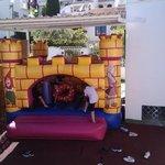 While the kids play on the bouncy castle / mientras los niños juegan en el castillo hinchable