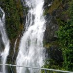 View of a waterfall from the train window