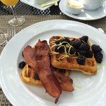Cornmeal waffles with blackberries, lemon zest and turkey bacon