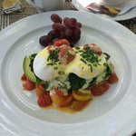 Eggs Benedict with avocado and tomatoes