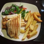 Homemade Cajun wrap with homemade chips and salad.. yummy lunch in Regans Bar