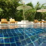pool with adequate supply of sun loungers