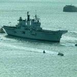 View of HMS Illustrious returning to Portsmouth Harbor