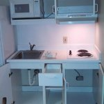 Kitchenette without pots, pans, or silverware